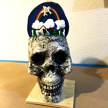 And here is Katie's diorama that she made in a cheap, plastic Dollar Tree skull.