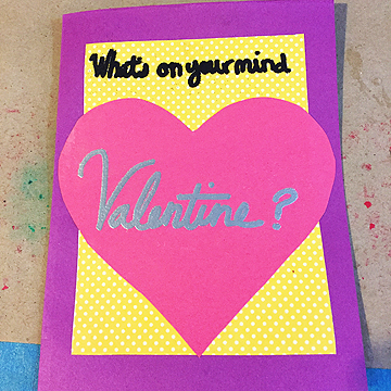 "Katie decided to do funny reveals for this project by captioning the thoughts people were having in vintage photographs. Using the phrase ""What's on your mind, Valentine?"" on the front of the card sets up the reveal when people open their cards."
